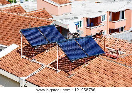 Solar panels on the house red tiled roof. Alternative energy.