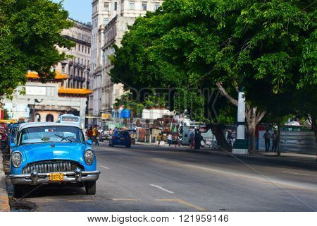 HAVANA, CUBA - JULY 17, 2013: Old vintage classic retro Chevrolet cars are on the street of Old Havana, Havana, Cuba. This is the most common mode of transportation for locals and tourists.