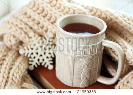 Beautiful winter composition with cup of hot drink, close up