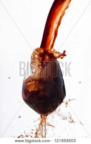 Red Wine Poured Vigorously Into A Wine Glass