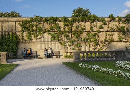 SALZBURG,AUSTRIA-MAY 10,2015:people are in rest on the bench inside the famous Mirabell gardens in Salzburg during a sunny day.
