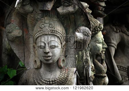 Wooden carved figure in gardens at Ancient Siam near Bangkok Thailand.