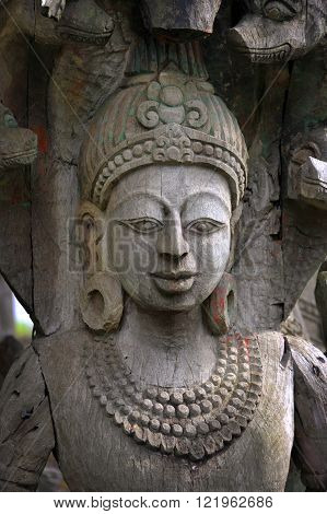 Wooden carved figure at Ancient Siam near Bangkok Thailand.