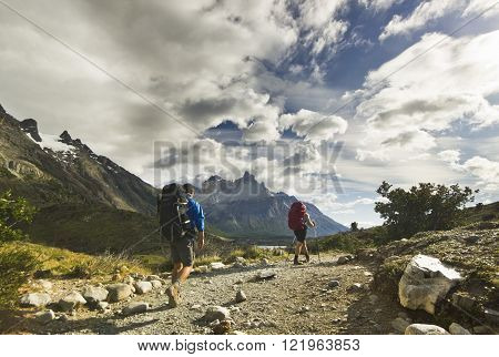 two men hiking in patagonia mountains, torres del paine
