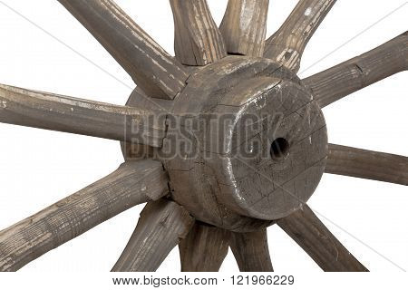 Left front closeup view of hub and spokes of vintage weathered wooden wagon wheel