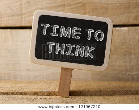 Time to think concept wooden sign on wood background