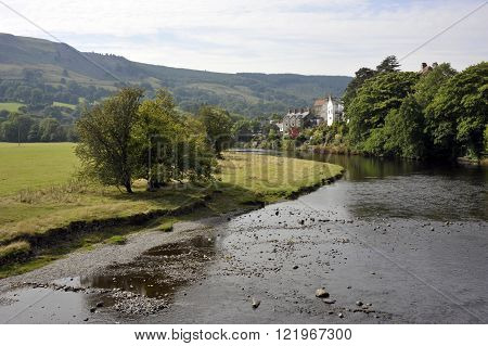 The River Dee and the village of Carrog, Denbighshire, Wales, UK.