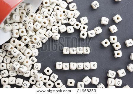 Tips and Tricks  word written on wood block. Wooden ABC