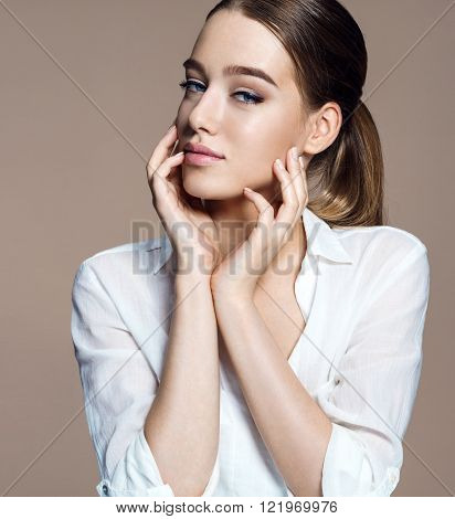 Beautiful girl with beautiful makeup youth and skin care concept / photoset of attractive brunette girl on beige background