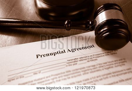 Prenuptial marriage agreement with a court gavel