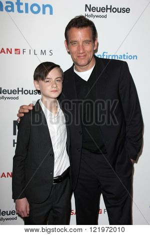 LOS ANGELES - MAR 15:  Jaeden Lieberher, Clive Owen at the The Confirmation Premeire at the NeueHaus on March 15, 2016 in Los Angeles, CA