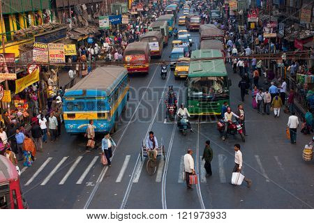 KOLKATA, INDIA - JANUARY 20: Big city street with thousands of people bikes and the buses on January 20, 2013 in Kolkata India. Kolkata has a density of 814.80 vehicles per km road length.