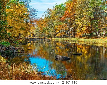 Colorful Autumn reflections on Tohickon Creek in Bucks County Pennsylvania.