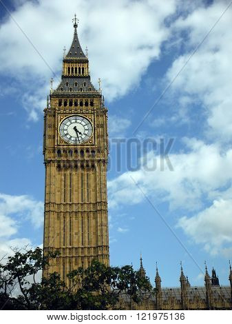 A side view of the Clock Tower (also known as Big Ben and Elizabeth Tower) of the London Westminster Parliament building complex.