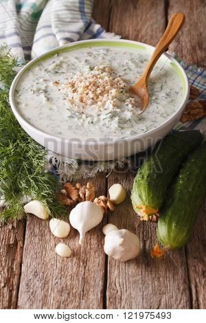 Bulgarian Summer Cold Soup Tarator Close Up And Ingredients On The Table. Vertical