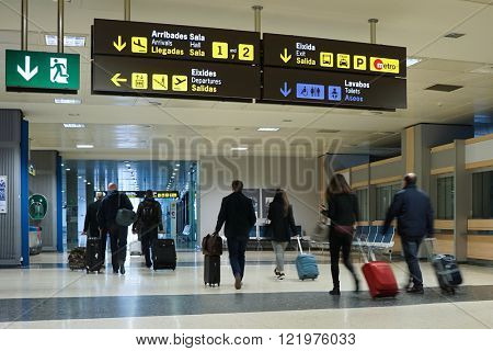 VALENCIA, SPAIN - MARCH 14, 2016: Airline passengers inside the Valencia Airport. About 4.59 million passengers passed through the airport in 2014.