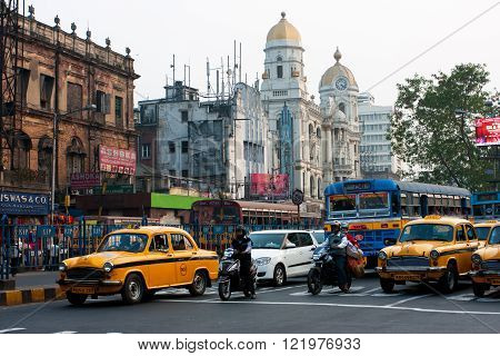 KOLKATA, INDIA - JAN 19: Motorbikes and the cars stopped on the road of old asian metropolis on January 19, 2013 in Kolkata India. Kolkata has a density of 814.80 vehicles per km road length.