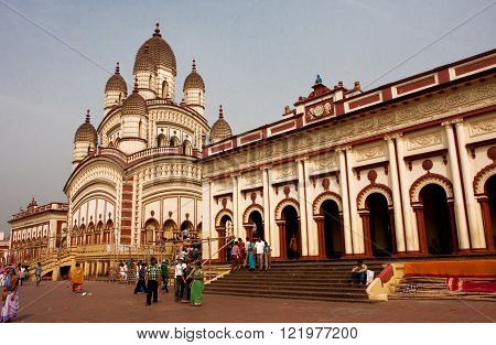 KOLKATA, INDIA - JAN 17: People walking around famous Dakshineswar Kali Temple at the bright day on January 17, 2013. The temple was built in nine spires style of Bengal architecture in 1855.