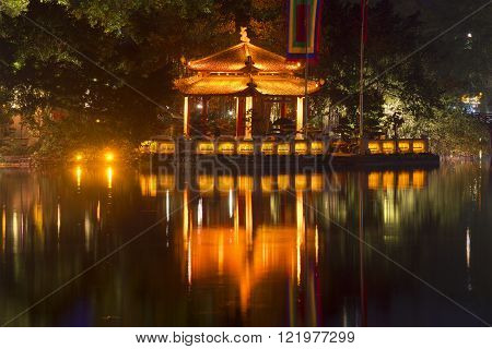 HANOI, VIETNAM - DECEMBER 13, 2015: Jade Temple on Hoan Kiem Lake in the night illumination close-up. The historic landmark of the city of Hanoi