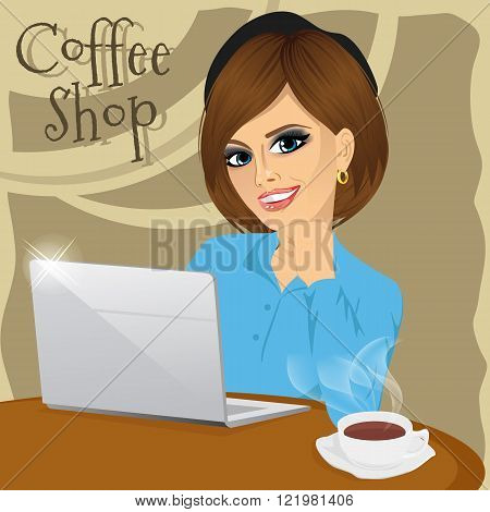 Beautiful young college student with laptop enjoying a hot coffee in coffee shop