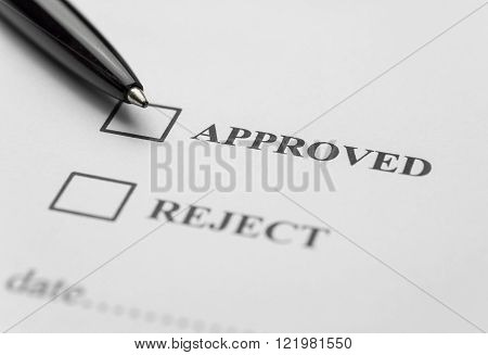 Approved and reject stamp with pen on white paper