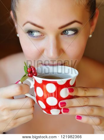 Beautiful woman holds the cup of cowberry tea ** Note: Shallow depth of field
