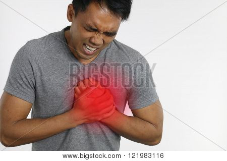 Heart attack - Man with chest pain over a white background