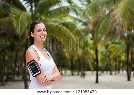 Fitness Woman Wearing Smartphone Armband At The Beach