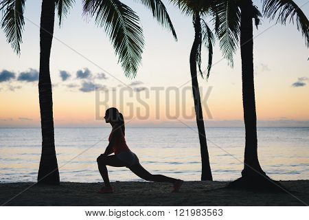 Fitness Woman Stretching On The Beach In The Morning