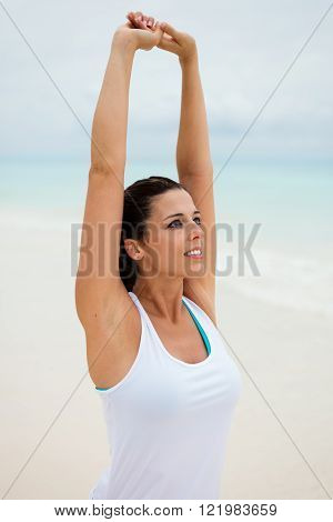 Stretching Arms Exercise For Relaxing At The Beach
