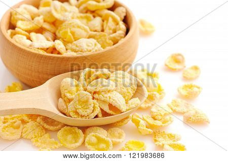 Cornflakes In A Wooden Spoon On White Background
