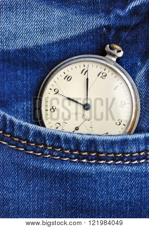 Old Pocket Watch In The Pocket Of Blue Jeans