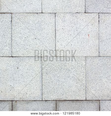 Concrete or cobble gray square pavement slabs or stones for floor wall or path