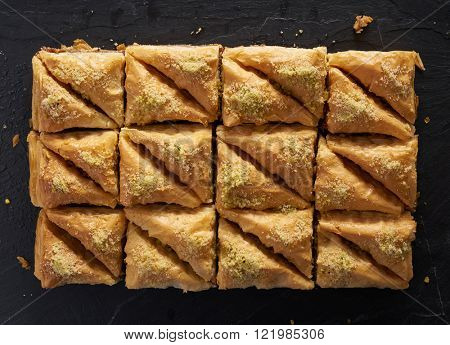 two dozen baklava in flat lay composition