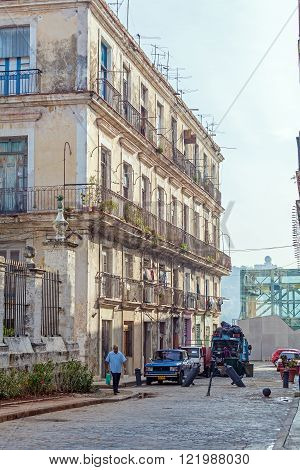 Havana, Cuba - April 1, 2012: Antique House And Garbage Truck