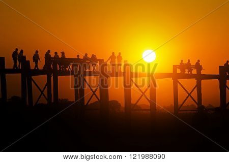 People walking on the U bein bridge, Teakwood, in Mandalay, Myanmar (Burma). ** Note: Visible grain at 100%, best at smaller sizes