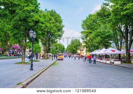 ODESSA, UKRAINE - MAY 18, 2015: The Deribasovskaya street is the best place to make an evening walk in the city centre, on May 18 in Odessa.