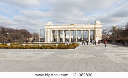 Moscow - March 13 2016: Central entrance to the Park of Culture and Rest named after Gorky a colonnade and a lot of people go for a walk in the park March 13 2016 Moscow Russia