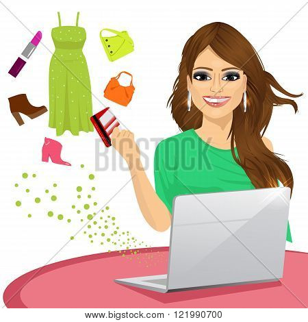 attractive woman shopping online using a laptop with her credit card buying some fashion goods