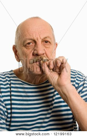 Elderly Man In A Stripped Vest Smokes