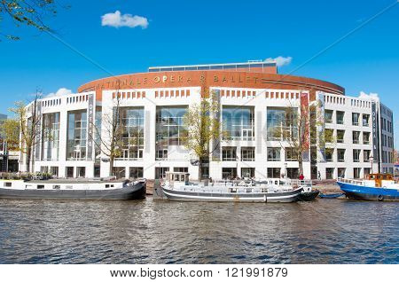 Amsterdam-April 30: Dutch National Opera & Ballet boats along the bank on April 302015. The Stopera is a building complex housing both the city hall and the Dutch National Opera & Ballet.