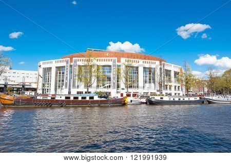 Amsterdam-April 30: Stopera and Dutch National Opera & Ballet on April 30 2015. The Stopera is a building complex housing both the city hall of Amsterdam and the Dutch National Opera & Ballet.
