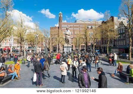 Amsterdam-April 30: Rembrandtplein with Rembrandt monument and bronze-cast representation The Night Watch by Russian artists Mikhail Dronov and Alexander Taratynov on April 30 2015 the Netherlands.