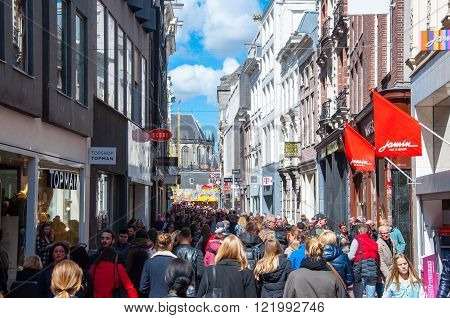 AMSTERDAM-APRIL 30: Crowd of people on Kalverstraat shopping street on April 30 2015 the Netherlands. The Kalverstraat is a busy shopping street of Amsterdam the capital of the Netherlands.