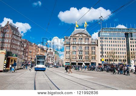 AMSTERDAM-APRIL 30: Dam Square with De Bijenkorf flagship store on the background on April 30 2015 in Amsterdam Netherlands.