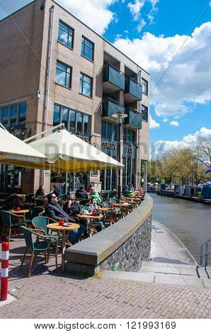 AMSTERDAM-APRIL 30: Undefined people have breakfast in Aran Irish Pub on April 302015 the Netherlands. Aran Irish Pub is a very relaxing and enjoyable place.