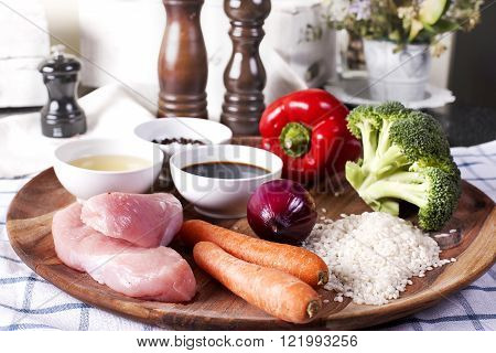Raw ingredients for Teriyaki Chicken with Steam Rice and vegetables. Plated meal on restaurant