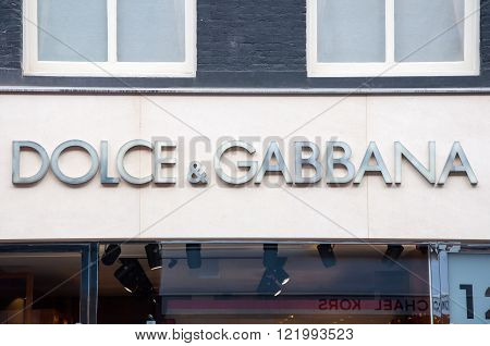 AMSTERDAM-APRIL 30: Dolce & Gabbana signboard on P.C.Hooftstraat shopping street on April 302015. The Italian fashion house was founded in 1985 by Italian designers