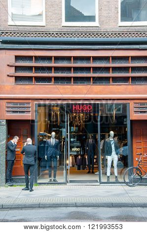 AMSTERDAM-APRIL 30: Hugo Boss store on the P.C.Hooftstraat shopping street on April 302015 the Netherlands. The German luxury fashion and style house was founded in 1924 by Hugo Boss.