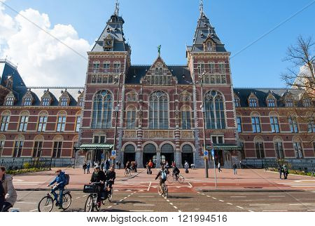 AMSTERDAM-APRIL 30: The Rijksmuseum crowd of people ride bicycles on April 30 2015. The Rijksmuseum is a Netherlands national museum dedicated to arts and history in Amsterdam.